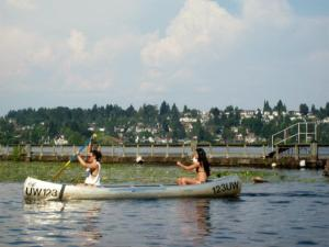 Lady canoeists on Lake Washington, a familiar scene in Seattle in the summer
